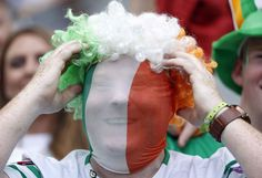 An Ireland supporter smiles on the stands before the Euro 2016 Group E soccer match between Belgium and Ireland at the Nouveau Stade in Bordeaux, France, Saturday, June 18, 2016. (AP Photo/Hassan Ammar)/XAF102/410394763739/1606181458