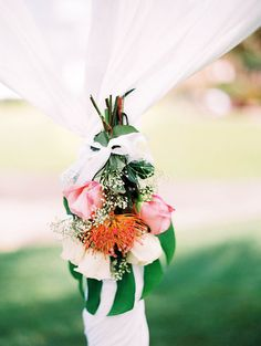 Photo from Jenn + Matt collection by Ashley Goodwin. Floral by Stacey Kaluahine Ochoa, Kauai Hi