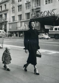 Shopping in San Francisco. Little boy looks like he would rather be someplace else.