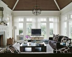 Love this family room by Tom Scheerer.  Grasscloth on the ceiling, yes!