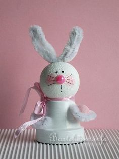 Clay pots for easter. White rabbit with Pipe cleaners and Styrofoam balls.