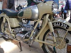 The Douglas Dragonfly was born in 1955 from the Douglas Motorcycle Company in the UK. Douglas switched from longitudinally mounted boxer motors to transversely mounted ones like this (like BMW, Zundapp, Dneper, etc)