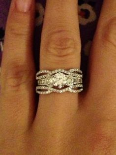 User submitted photo- solitaire in a dainty ring guard from zales.... maybe something similar for my band?