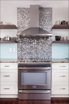 Glass tile backdrop - easy to clean, looks clean. Look good with cream cabinets.