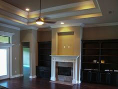 recessed TV over fireplace with cabinets on side