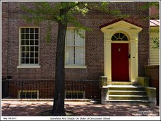 Sunshine and shade adorns an 18th century Ridout Row town house on Duke of Gloucester Street in Annapolis Maryland. Photograph published on May 15th 2015. To see a full size version of this photograph and the Annapolis Experience Blog article click on the Visit Site button. Image and article Copyright © 2015 G J Gibson Photography LLC.