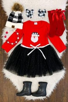 Fun flair and sweet style come together in this charming Santa Tutu Dress. This long sleeve dress features a red top, and a black tutu skirt. The tulle overlay on this dress flows gently over the skirt, adding sweet appeal to this pretty dress. All she needs are some sparkly sneakers to complete this perfect winter look Black Tutu Skirt, Dress Skirt, Girls Christmas Outfits, Alice, Sweet Style, Winter Looks, Boutique Clothing, Pretty Dresses, Cheer Skirts