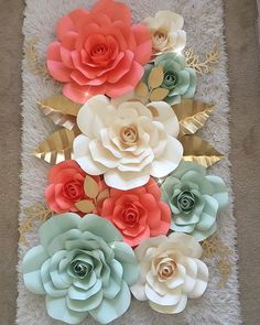 HERE SHE IS MY VERY OWN PAPER FLOWER BACKDROP AND I USED TEMPLATE 116 and KING ROSE CENTER TEMPLATE  I will be putting these beauties up in my art room  the green paper is from KELLY PAPER I believe it called GREEN and the SALMON colour paper is from KELLY PAPER called SALMON  and the Ivory paper is called WARM WHITE from KELLY PAPER  I spay painted all the leaves gold from @michaelsstores  #paperflowers #paperflower #handmade #diy #artroom #kellypaper #madewithmichaels #love