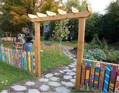 School Garden : Children's Garden let the kids paint the fence around their play area.
