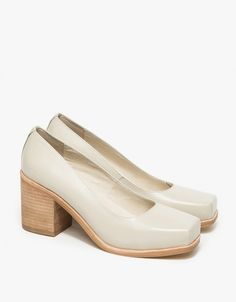 A classic leather slip on heel with thick heel structure in Bone from INTENTIONALLY BLANK. Features squared toe, leather uppers, fully leather lined, German sole and stacked heel.  •Classic leather slip on heel in Bone •Squared toe •Leather upper
