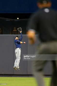 Kevin Kiermaier #39 of the Tampa Bay Rays makes a leaping catch on Stephen Drew #14 of the New York Yankees fly ball at Yankee Stadium on July 3, 2015 in the Bronx borough of New York City.