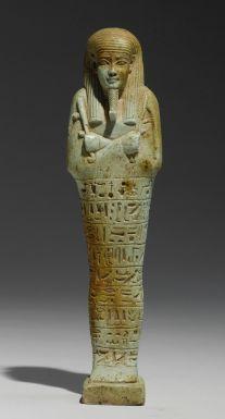 AN EGYPTIANPALE BLUE-GREEN USHABTI OF NEFERIBRESANEITH,  26TH DYNASTY, REIGN OF AMASIS, 570-526 B.C.
