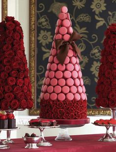 A French touch to your holiday soiree. 'A Feast of Roses' with towers of pink macaroons and red sugar roses and chocolate-wrapped rose raptures, cupcakes and truffles