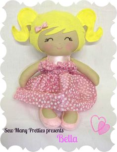 This pretty girl is ready to dance into your heart. She is handmade and 15 inches tall. Her body is made from pink satin. She wears a pink underskirt and has a removable pink organza skirt.  www.sewmanypretties.com