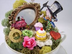 I think mine are cuter!  Mad Hatter's Tea Cup Centerpiece or Cake Topper by thefaerywatcher, $75.00