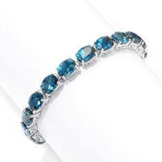 Gem Treasures® Sterling Silver 25.67ctw Oval London Blue Topaz Tennis Bracelet