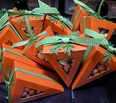 Triangle boxes made to look like carrots for Easter treats.