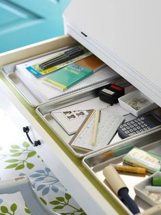 Organizing your drawers can be easy and simple. You can find budget friendly drawer organizers at Target or the Container Store to sort everything in your drawers and cabinets. Get creative  and use baking pans instead for very narrow storage spaces to keep your drawers clutter free.