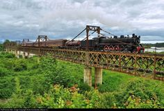 es44c4:  Train of Araucanía, with the steam locomotive Mountain No. 820 (built in 1940 by Baldwin Locomotive Works), on special service with european and north american railfans tourist (Railway Touring Company), crosses the Tolten bridge between Pitrufquen - Freire, region of Araucania in the south of Chile. (via RailPictures.Net Photo: No. 820 Museo Ferroviario Pablo Neruda De Temuco Steam 4-8-2 at Pitrufquen, Chile by Entre Durmientes (Mauro C.))