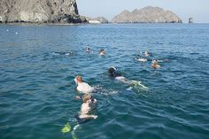 Sailors assigned to the amphibious assault ship USS Kearsarge (LHD 3) and Marines attached to the 26th Marine Expeditionary Unit (MEU) swim during a Morale, Welfare and Recreation (MWR) tour.