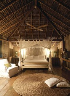 attic bedroom--love the bed/canopy...ceiling of course...LOVE the round sisal rug!