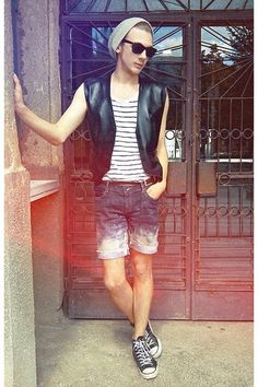 I love this outfit! This is something I could see myself styling on someone. It has an edginess to it, but is super fashion forward with the dyed ombre shorts and the leather vest. It gives off the impression of a city hipster look...