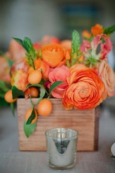 Orange and pink ranunculus with kumquats for centerpieces