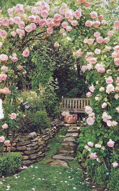 I love pink roses over an arbor!