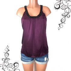 """EXPRESS plum wine silk top w beaded neckline Pretty deep plum or red wine colored silk top that feels so nice and smooth. It has a gorgeous black beaded neckline, no necklace needed.  Great work blouse!   Condition: gently used, been washed a few times, good condition overall, all beads are intact, no snags or holes, just missing its original string belt, but it looks fine without one imo Sizes: XS Bust: 16 inches  Length: 27"""" Fabric: 95% silk, 5% spandex  🚫trade Express Tops Blouses"""