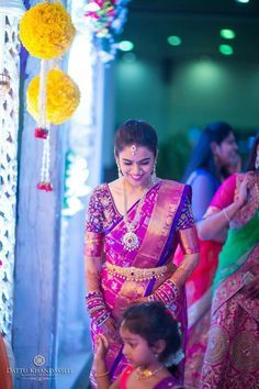 South Indian bride. Diamond Indian bridal jewelry. Jhumkis.Pink and purple silk kanchipuram sari.Braid with fresh jasmine flowers. Tamil bride. Telugu bride. Kannada bride. Hindu bride. Malayalee bride.Kerala bride.South Indian wedding.