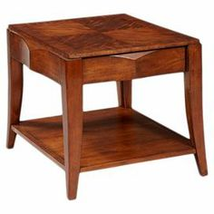 "Midcentury-inspired poplar wood end table with prima vera veneers and a drawer.  Product: End tableConstruction Material: Prima vera veneers and poplar solidsColor: Amber brownFeatures:  One drawerOne shelf Dimensions: 23"" H x 25.38"" W x 30.38"" D"