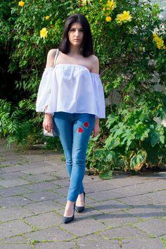 DIY embroidered jeanswhite off shoulder top, black heeled pumps