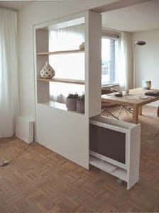 Meubelatelier Mens maakt meubels en interieurbouw op maat.   Deze scheidingwand waar de televisie in weggeschoven  kan worden...