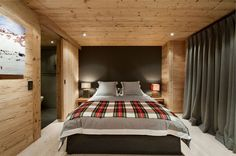Master Bedroom with Pallet Wall at Luxury Chalet in Gstaad by Ardesia Design, Architecture & Interior, 1200x798 pixels