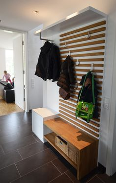 Love the graphic use of the wood slats and the movable … Tischlermeister Gervink. Love the graphic use of the wood slats and the movable hooks for changing needs. Hallway Closet, Hallway Storage, Closet Bedroom, Closet Storage, Cloakroom Storage, Ikea Hallway, Ikea Wall, Long Hallway, Cabinet Storage