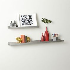 Our sleek Metal Aluminum Wall Shelves ledges with upturned edges play attention-getting supporting role for photos, artwork and objects of interest. Weather-proof brushed finish goes indoors and out. Fun to stagger down the wall.