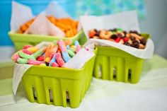 Goldfish crackers, trail mix and gummy worms were put out in plastic berry baskets for snacking.