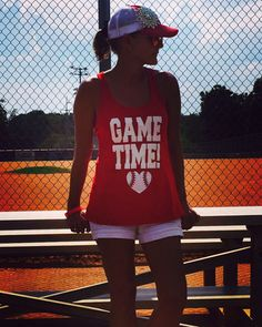 """Shop now....What's the most important time in a baseball mom's day? GAME TIME! Don your enthusiasm for your kid, your team, and your sport with this light-weight, racerback """"Game Time"""" tank. White glitter lettering, and several color options to choose from. Sizing is Ladies and runs smaller than Unisex. Free shipping."""
