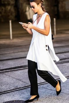 Need some help pulling off the dress over pants trend? These examples will show you exactly how to wear a dress over pants. Minimalist Winter Outfit, Summer Minimalist, Minimalist Fashion, Minimalist Outfits, Minimalist Style, Summer Work Outfits, Summer Outfits Women, Office Looks, Black Women Fashion