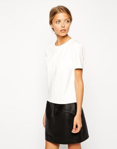 T-shirt by ASOS Collection Smooth scuba fabric Crew neckline Keyhole cut and button fastening to reverse Regular fit - true to size Machine wash 88% Polyester, 12% Elastane Our model wears a UK 8/EU 36/US 4