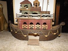 Wooden Noahs Ark With Rope and Bead Accents. Comes with some animals made of resin and some have chips and one of the turtles are missing a head. The Ark however, is in great condition. This is stunning and would look awesome just displayed! | eBay!