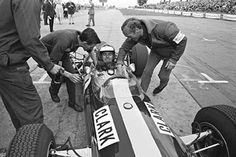 Jim Clark / Colin Chapman (1965) Celebrating the Lotus win at the Nurburgring, which would give Clark his second world champion title.