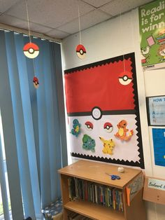 Use your children's interest in Pokemon to create an exciting reading area. Could you use this idea as inspiration for your own classroom reading area? Superhero Classroom Door, Classroom Board, High School Classroom, Classroom Projects, School Art Projects, Classroom Themes, Pokemon Decor, Pokemon Room, Classroom Reading Area
