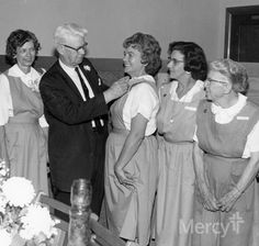 "Who loves volunteers! We do! Check out the Pink Ladies getting ""pinned"" for their service in the late 50s at Mercy Hospital Jefferson. This volunteer program is celebrating its 55th year of service this year! #throwbackthursday #tbt"