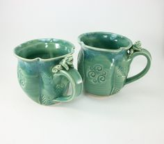 pair of jade colored frog mugs made by Gary Rith
