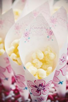 luau-birthday-party-popcorn-cones- this site had a ton of cute idea for a luau birthday party!