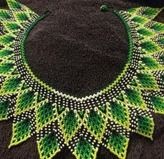 Not the typical bold colors, which makes this just as memorable and a little more wearable. Bracelets, Necklaces, Homemade Jewelry, Seed Beads, Beadwork, Beading, Beaded Jewelry, Diy And Crafts, Crochet Necklace