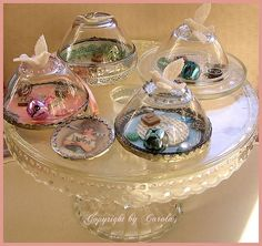 Soldered glass paper weights, with moving parts inside so you can shake it and move them around a bit like a snowglobe.