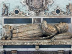 "The ""noble imp"" Robert Dudley, Lord Denbigh, son of Robert Dudley Earl of Leicester (""Elizabeth's Robin"") and his wife, Lettice Knollys. Died 19 July 1584, age 3. St. Mary's Church, Warwick, in the Beauchamp Chapel. His feet rest on a bear; the Warwick bear & ragged staff are visible above."