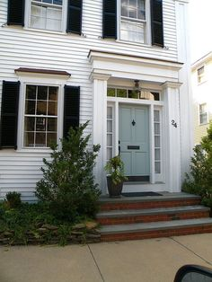 I want my front door this color blue -   white house exterior, blue door, and black shutters
